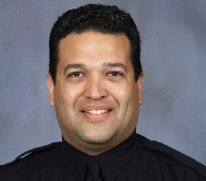 This photo provided by the Lincoln, Neb., police department, shows Lincoln police officer Luis