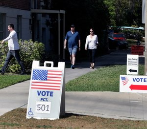 Voters head to a polling station to vote in Florida's primary election in Orlando, Fla. (AP Photo/John Raoux)