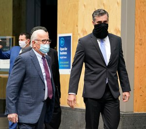 Former Minneapolis Police Officer Thomas Lane, right, walks out of a hearing with attorney Earl Gray at the Hennepin County Family Justice Center Friday, Sept. 11, 2020, in Minneapolis.