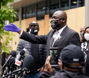 Attorney Ben Crump, representing George Floyd's family, addresses the media after a hearing at the Hennepin County Family Justice Center, Friday, Sept. 11, 2020, in Minneapolis.