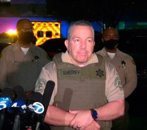 This still image taken from video released by the Los Angeles County Sheriff's Department, shows Sheriff Alex Villanueva taking questions at a late-night news conference about the condition of two Sheriff's deputies in Compton, Calif on Saturday, Sept. 12, 2020. (Los Angeles County Sheriff's Department via AP)