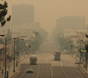 Smoke from wildfires fills the sky over Pasadena, Calif., on Saturday, Sept. 12, 2020. Stanford University researchers estimated that between 1,200 and 3,000 people died as a result of California wildfire smoke between Aug. 1 and Sept. 10. (AP Photo/John Antczak, File)