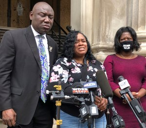 Tamika Palmer, mother of Breonna Taylor, addresses the media in Louisville, Ky., on Thursday, Aug. 13, 2020. The city of Louisville will pay $12 million to Taylor's mother and install police reforms to settle a lawsuit from Taylor's family. (AP Photo/Dylan Lovan)
