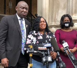 Tamika Palmer, mother of Breonna Taylor, addresses the media in Louisville, Ky., on Thursday, Aug. 13, 2020. The city of Louisville will pay $12 million to Taylor's mother and install police reforms to settle a lawsuit from Taylor's family.