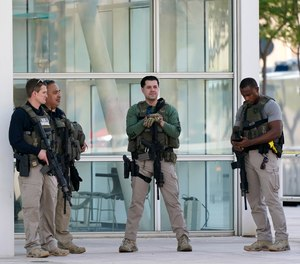 Federal law enforcement personnel stand outside the Sandra Day O'Connor Federal Courthouse Tuesday, Sept. 15, 2020, in Phoenix.