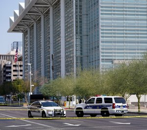 Police cars close off a street outside the Sandra Day O'Connor U.S. Courthouse in Phoenix, on Tuesday, Sept. 15, 2020.