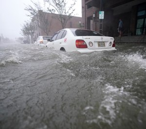 Flood waters move on the street, Wednesday, Sept. 16, 2020, in Pensacola, Fla. Hundreds of people required evacuation or rescue after the Category 2 Hurricane Sally made landfall last week. (AP Photo/Gerald Herbert)
