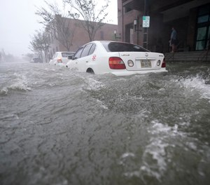 Flood waters move on the street, Wednesday, Sept. 16, 2020, in Pensacola, Fla. Hundreds of people required evacuation or rescue after the Category 2 Hurricane Sally made landfall last week.