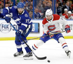 In this March 5, 2020, file photo, Tampa Bay Lightning defenseman Victor Hedman (77) breaks up a pass intended for Montreal Canadiens center Nick Suzuki (14) during the first period of an NHL hockey game in Tampa, Fla. (AP Photo/Chris O'Meara, File)