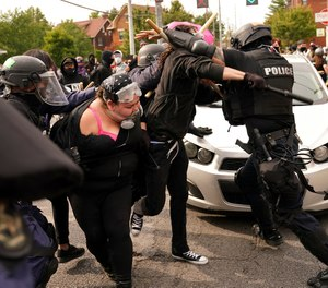 Police and protesters clash during a demonstration over a lack of charges against Louisville police in Breonna Taylor's death Wednesday, Sept. 23, 2020, in Louisville, Ky.