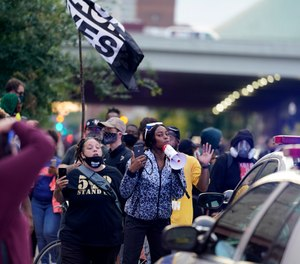 Black Lives Matter protesters march, Friday, Sept. 25, 2020, in Louisville. (Photo/AP Photo/Darron Cummings)