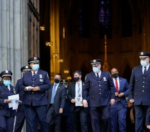 Members of the New York Police Department leave a service honoring the 46 members of the NYPD who have died due to COVID-19 related illness, Monday, Oct. 5, 2020, at St. Patrick's Cathedral in New York.