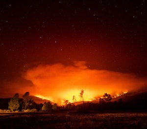 In this Sept. 16, 2020 photo, the August Complex Fire burns near Lake Pillsbury in the Mendocino National Forest, Calif. The August Complex, California's largest-ever wildfire, surpassed 1 million acres on Monday.