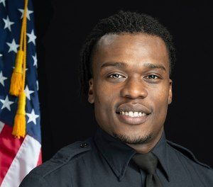 This undated photo in Wauwatosa, Wis., shows Wauwatosa Police Officer Joseph Mensah. (Gary Monreal/Monreal Photography LLC/Wauwatosa Police Department via AP)