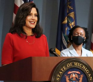 In this photo Sept. 16, 2020 file photo, Gov. Whitmer addresses the state during a speech in Lansing, Mich.