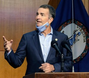 Virginia Gov. Ralph Northam answers a reporter's question during a news briefing in Richmond, Va.