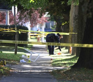 In this Saturday, Sept. 19, 2020, file photo, a Rochester police technician collects evidence near the home where a fatal house party took place in Rochester, N.Y. (Tina MacIntyre-Yee/Democrat & Chronicle via AP)