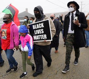 People march during a protest rally for Marcellis Stinnette who was killed by Waukegan Police last Tuesday in Waukegan, Ill., Thursday, Oct. 22, 2020.