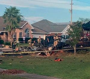 A U.S. Navy training plane crashed in an Alabama residential neighborhood near Foley, Ala.