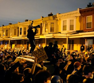 Protesters confront police during a march Tuesday Oct. 27, 2020 in Philadelphia.