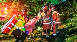 Atlanta firefighters transport a man they freed who was trapped in his third-floor bedroom after a tree came crashing down on a home as Tropical Storm Zeta swept across the Southeast Thursday, Oct. 29, 2020.