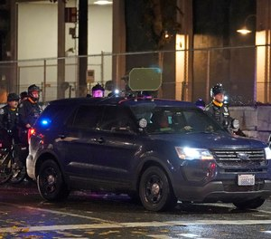 A Seattle Police vehicle with a high-volume speaker mounted on top sits parked in front of the SPD East Precinct building, Wednesday, Nov. 4, 2020, as protesters clashed with police in Seattle. The speaker is part of a new practice by Seattle police to issue audible warnings to protesters during protest activities, and authorities also use to issues apologies to nearby residents for any disruptions caused by the activities.