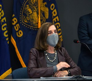 Oregon Gov. Kate Brown attends a news conference Tuesday, Nov. 10, 2020, in Portland, Ore.