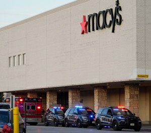 Police investigate a shooting at the Mayfair Mall, Friday, Nov. 20, 2020, in Wauwatosa, Wis.