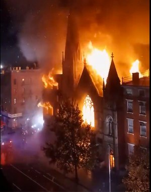 A historic 19th century church in lower Manhattan was gutted by a massive fire that sent flames shooting through the roof.