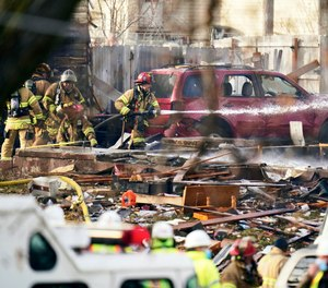 Firefighters work the scene of a deadly explosion that leveled a home in Omaha, Neb., Tuesday, Dec. 8, 2020. Two people were killed and two were critically injured in the blast.
