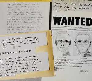 In this May 3, 2018, file photo, a San Francisco Police Department wanted bulletin and copies of letters sent to the San Francisco Chronicle by a man who called himself Zodiac are displayed in San Francisco.