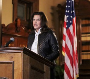 In this Oct. 8, 2020 file photo Michigan Gov. Gretchen Whitmer addresses the state during a speech in Lansing, Mich.
