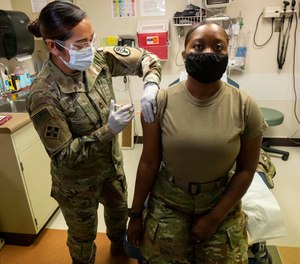 Sgt. First Class Doreen Fajota gives Sgt. Brittany Koppenhaver a Moderna COVID-19 vaccine Tuesday, Dec. 22, 2020, at Evans Army Community Hospital as Fort Carson U.S. Army Base in Colorado Springs became the first military installation in Colorado to administer the vaccine.