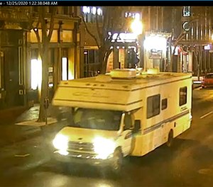 This image taken from surveillance video provided by Metro Nashville PD shows a recreational vehicle that was involved in a blast on Friday, Dec. 25, 2020 in Nashville, Tenn.