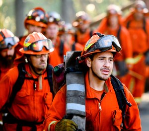 California Gov. Gavin Newsom's proposed budget asks for $143 million to fund more than 600 state firefighter positions. The state faced a shortage of available inmate firefighting crews during record-breaking fires last year.