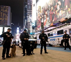In this Dec. 31, 2011, file photo, police officers stand guard during the New Year's Eve celebration in New York's Times Square.