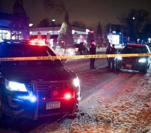 The scene at 36th St. and Cedar Ave. S. after a man was shot and killed by Minneapolis Police Wednesday, Dec. 30, 2020, in Minneapolis.