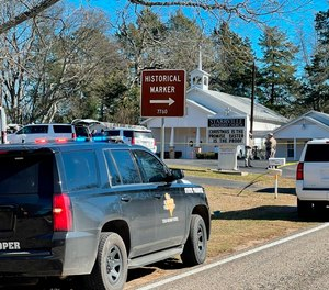 The Smith County Sheriff's Office investigates a fatal shooting incident at the Starville Methodist Church in Winona, Texas, on Sunday morning, Jan. 3, 2021.