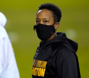 Washington full-year coaching intern Jennifer King looks on prior to an NFL wild-card playoff football game between the Washington Football Team and the Tampa Bay Buccaneers, Saturday, Jan. 9, 2021, in Landover, Md.