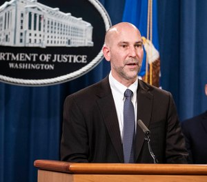 Steven D'Antuono, head of the Federal Bureau of Investigation (FBI) Washington field office, speaks as acting U.S. Attorney Michael Sherwin, right, listens during a news conference Tuesday, Jan. 12, 2021, in Washington.