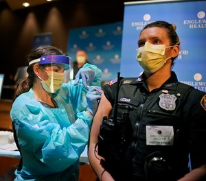 Police officer Jennifer Leeman is receives a COVID-19 vaccine at Englewood Health in Englewood, N.J., Thursday, Jan. 14, 2021.