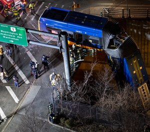 A bus in New York City that careened off a road in the Bronx was left dangling from an overpass late Thursday. The driver of the bus was seriously injured, and seven passengers sustained minor injuries.