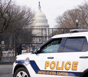Security surrounds the U.S. Capitol in Washington, Friday, Jan. 15, 2021, ahead of the inauguration of President-elect Joe Biden.