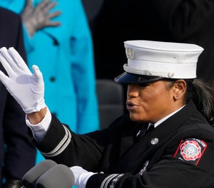 Fire Capt. Andrea Hall signs the Pledge of Allegiance at the 59th Inaugural Ceremonies of President Joe Biden and Vice President Kamala Harris.