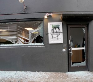 A crowd carrying anti-President Joe Biden and anti-police signs marched in the streets and damaged the headquarters of the Democratic Party of Oregon, Wednesday, Jan. 20, 2021.