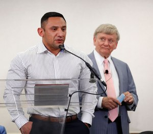 Houston Police officer Felipe Gallegos speaks as lawyer Rusty Hardin listened during a press conference at Hilton Americas, Tuesday, Jan. 26, 2021, in Houston.
