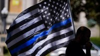 State your case: Should the thin blue line flag be banned from police departments?