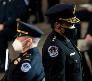Capitol Police Acting Chief Yogananda Pittman departs a ceremony memorializing U.S. Capitol Police officer Brian Sicknick on Feb. 3, 2021, in Washington.