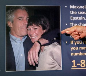 In this July 2, 2020, file photo, Audrey Strauss, acting U.S. attorney for the Southern District of New York, points to a photo of Jeffrey Epstein and Ghislaine Maxwell during a news conference in New York.