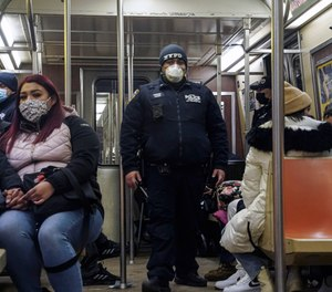 Police patrol the A line subway train bound to Inwood, after NYPD deployed an additional 500 officers into the subway system following a series of deadly stabbing attacks.